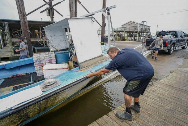 PHOTO: Shrimpers secure their boat on a trailer to bring to higher ground as Hurricane Zeta approaches on Oct. 28, 2020, in Shell Beach, La. (Sandy Huffaker/Getty Images)