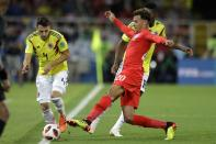 <p>Dele Alli tries to stop Colombia's Santiago Arias from breaking down the touchline </p>
