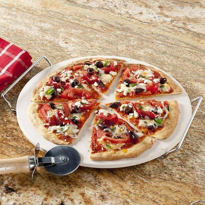 <p>Encourage them to create the yummiest homemade pizzas with this sleek <span>Nordic Ware 3-Piece Pizza Baking Set</span> ($11). It comes with a pizza cutter, a pizza stone, and serving handles.</p>