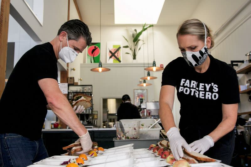 FILE PHOTO: Chris and Amy Hillyard, owners of Farley's East, pack lunches for World Central Kitchen, amid the coronavirus disease (COVID-19) outbreak, in Oakland, California