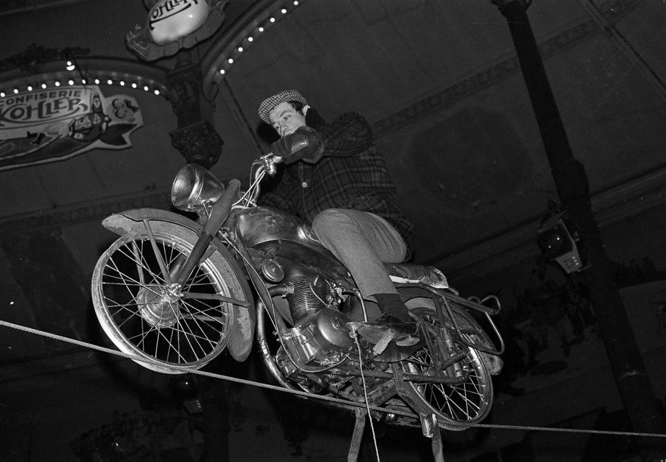 FILE - In this Feb. 5, 1963 file photo, French actor Jean-Paul Belmondo rehearses his motorcycle tightrope act at the Medrano Circus in Paris. French New Wave actor Jean-Paul Belmondo has died, according to his lawyer's office on Monday Sept. 6, 2021. (AP Photo/Jacques Marqueton, File)