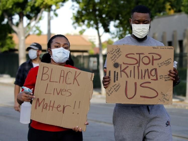 Protesters walk on Philadelphia St. during George Floyd/Black Lives Matter march through uptown Whittier on Sunday, May 31, 2020. About 500 people walked from city hall to Whittier Blvd. north, east on Hadley St.. and back to city hall. Many chanted Balck Lives Matter, I can't Breathe and other slogans related to the march.