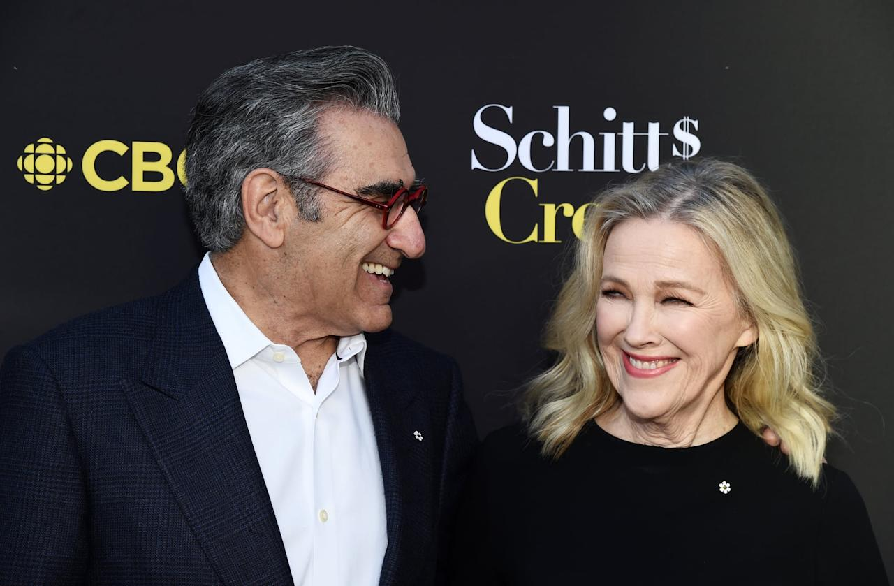 """<ul> <li><strong>On <a href=""""http://www.hollywoodreporter.com/live-feed/schitts-creeks-eugene-levy-catherine-761841"""" target=""""_blank"""" class=""""ga-track"""" data-ga-category=""""internal click"""" data-ga-label=""""http://www.hollywoodreporter.com/live-feed/schitts-creeks-eugene-levy-catherine-761841"""" data-ga-action=""""body text link"""">working alongside Catherine</a>: </strong>""""We've known each other for such a long time that it's just a comfortable relationship. And when you're doing comedy, number one, you do want to work with the best people. It's hard when you're not working with the best people, so the bottom line is you want really good people who are quite skilled at this particular kind of comedy, [which is] character work. Quite honestly, it's so much fun working with her, [but I also] know I'm working with the best person I could hire for the role.""""</li> <li><strong>On <a href=""""http://youtube.com/watch?v=NDTrneR7lRE"""" target=""""_blank"""" class=""""ga-track"""" data-ga-category=""""internal click"""" data-ga-label=""""http://youtube.com/watch?v=NDTrneR7lRE"""" data-ga-action=""""body text link"""">their amazing chemistry</a>: </strong>""""It's always been fun working with Catherine and it's just familiarity. For me, it kind of ups your game. You got to make sure you're putting as much into it as Catherine always does.""""</li> </ul>"""