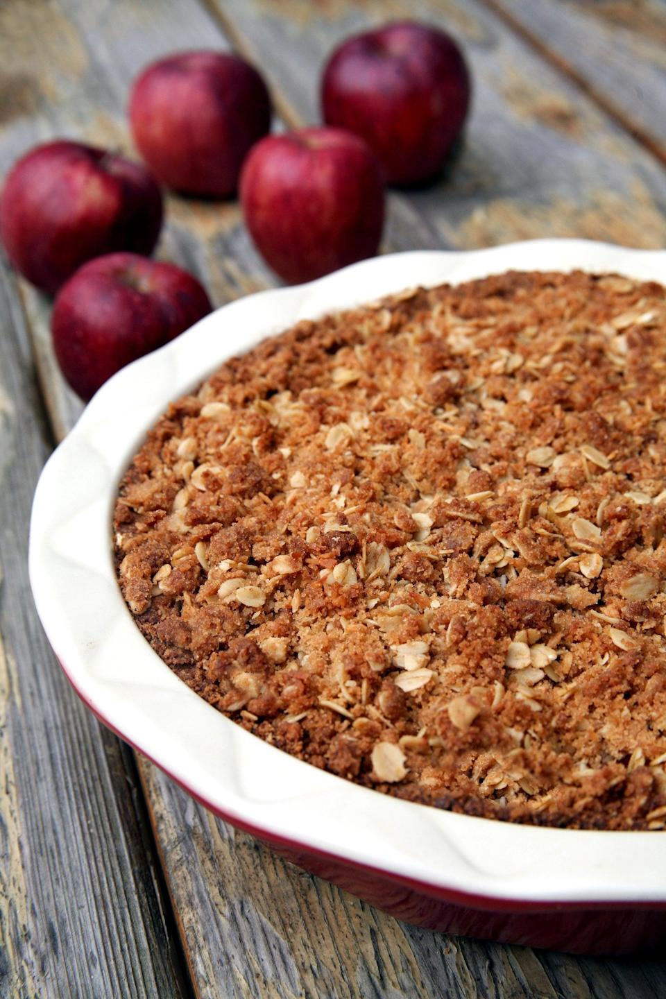 "<p>Life is full of too many tough decisions, so if you can't choose between baking apple pie or apple crisp, then don't! This lightened-up recipe marries these two traditional desserts into one glorious, warm, and spicy treat that you'll feel proud bringing to your next holiday dinner.</p> <p><strong>Get the recipe:</strong> <a href=""https://www.popsugar.com/fitness/Vegan-Apple-Pie-36081996"" class=""link rapid-noclick-resp"" rel=""nofollow noopener"" target=""_blank"" data-ylk=""slk:apple coconut crumble pie"">apple coconut crumble pie</a></p>"