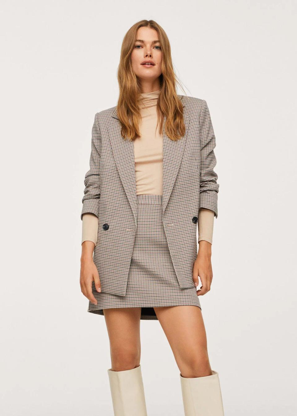 <p>We almost can't picture fall without a plaid blazer or a <span>Check Design Skirt</span> ($50). Whether you style it with a turtleneck or a thick sweater, you will move with ease, style, and confidence.</p>