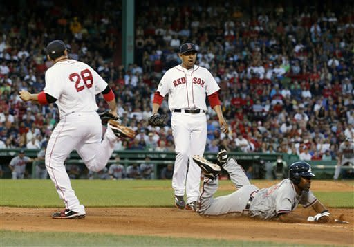 Boston Red Sox's Adrian Gonzalez (28) can not make the play after fielding a single by Atlanta Braves' Michael Bourn, right, in the third inning of a baseball game in Boston, Saturday, June 23, 2012. Boston's Franklin Morales is at center. (AP Photo/Michael Dwyer)