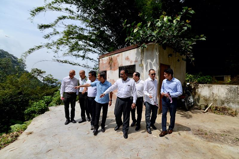 State Exco Jagdeep Singh Deo (centre) and MBPP Mayor Datuk Yew Tung Seang (fourth left) visit the original P84 station August 27, 2018.