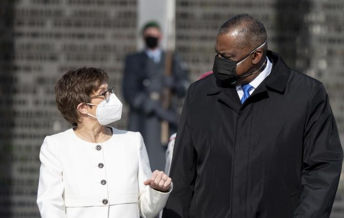 Annegret Kramp-Karrenbauer, Federal Minister of Defence, receives US Secretary of Defence Lloyd Austin at the Federal Ministry of Defence in Berlin, Germany, Tuesday, April 13, 2021. This is the first visit to Germany by a minister of the new US administration. Austin will then travel on to Stuttgart, where he will talk to soldiers at the US command centres for troops in Africa and Europe. (Kay Nietfeld/dpa via AP)