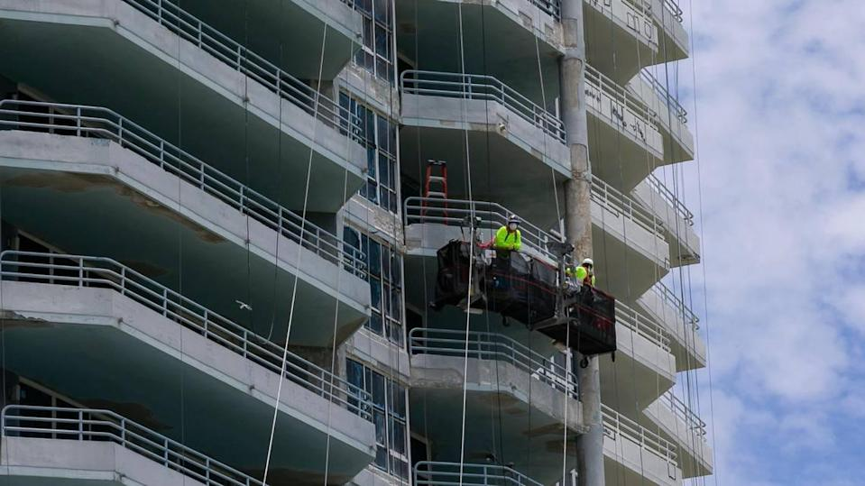 Construction employees work to renovate the Hamilton on the Bay in Miami's increasingly popular Edgewater neighborhood.