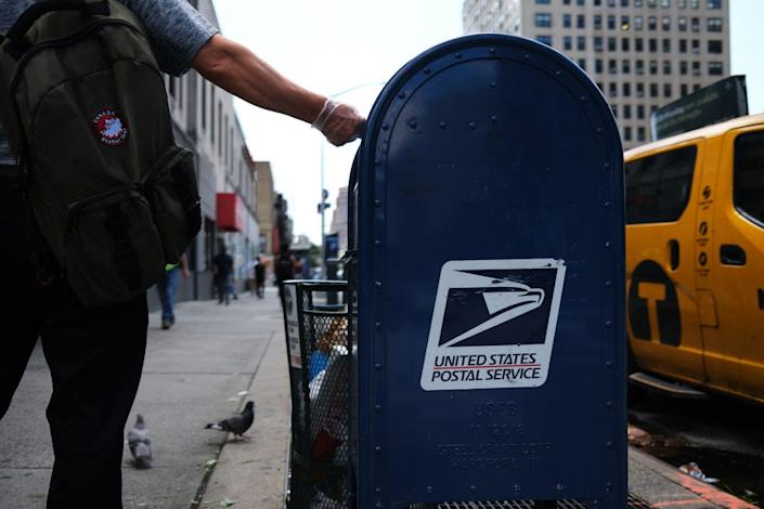 """Deep financial turmoil exacerbated by the pandemic has Democratic lawmakers and postal leaders pushing for a bailout. <p class=""""copyright""""><a href="""