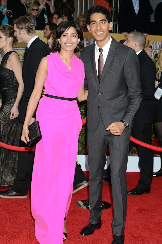 Freida Pinto (L) and Dev Patel arrive at the 19th Annual Screen Actors Guild Awards at the Shrine Auditorium in Los Angeles, CA on January 27, 2013.