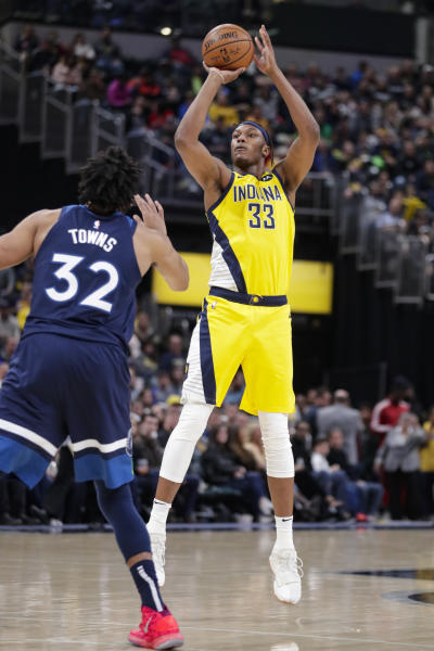 Indiana Pacers center Myles Turner (33) shoots over Minnesota Timberwolves center Karl-Anthony Towns (32) during the second half of an NBA basketball game in Indianapolis, Friday, Jan. 17, 2020. The Pacers won 116-114. (AP Photo/Michael Conroy)