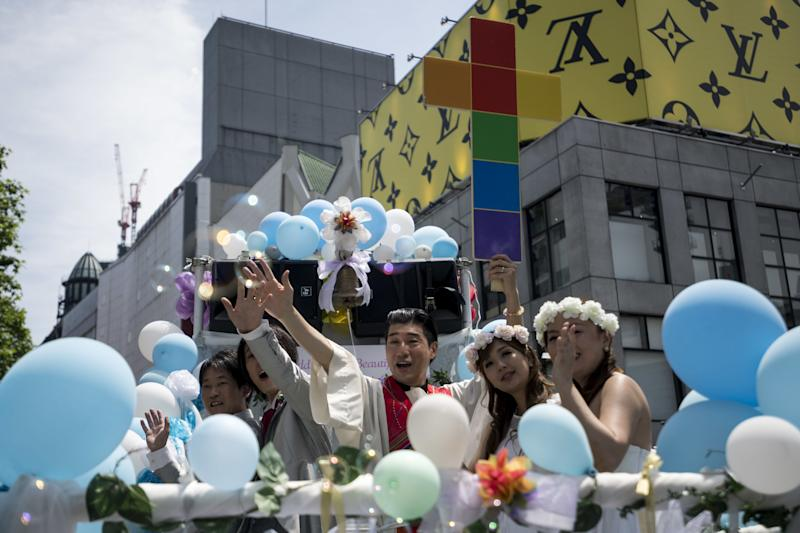 Participants dressed in wedding clothes march in the Tokyo Rainbow Pride Parade.