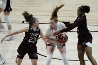Stanford's Ashten Prechtel battle with Missouri State's Mya Bhinhar (23) and Jasmine Franklin during the second half of an NCAA college basketball game in the Sweet 16 round of the Women's NCAA tournament Sunday, March 28, 2021, at the Alamodome in San Antonio. (AP Photo/Morry Gash)