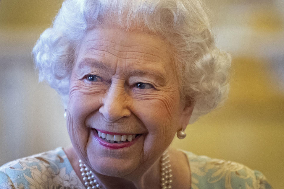 Britain's Queen Elizabeth II smiles as she talks with trustees and staff from The Queen's Trust during a reception in Buckingham Palace, London on October 17, 2019, to mark the work of The Queen's Trust. - The Queens Trust began as The Silver Jubilee Appeal Fund in 1977, with the aim of helping young people to help others. The Queens Commonwealth Trust, will continue the legacy of the Trusts work going forward. (Photo by Victoria Jones / POOL / AFP) (Photo by VICTORIA JONES/POOL/AFP via Getty Images)