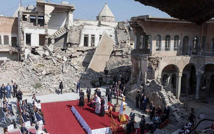 The Pope leading prayers amid the rubble - Sam Tarling for The Telegraph