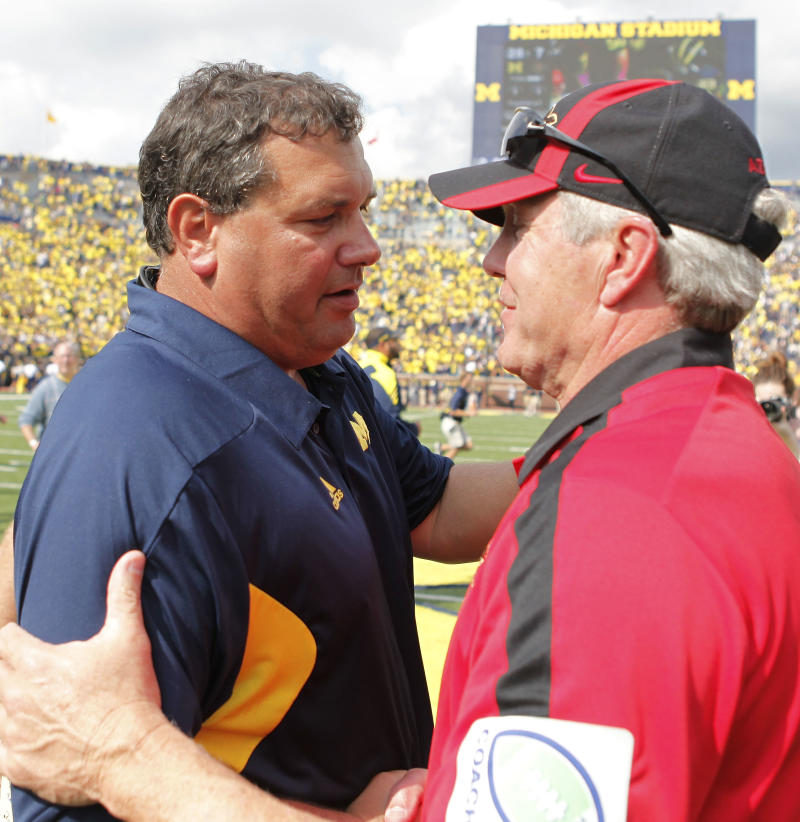 ANN ARBOR, MI - SEPTEMBER 24: Michigan Wolverines head coach Brady Hoke and San Diego State's head coach Rocky Long meet on the field after the game at Michigan Stadium on September 24, 2011 in Ann Arbor, Michigan. Michigan defeated San Diego 28-7. (Photo by Leon Halip/Getty Images)