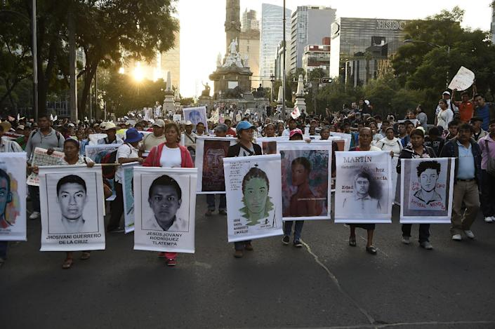 People take part in a demostration demanding information on the whereabouts of the 43 missing students from Ayotzinapa, in Mexico City on November 5, 2014 (AFP Photo/Ronaldo Schemidt)