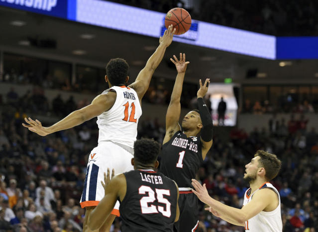 Gardner-Webb's Jahean Cornwall (1) shoots as Virginia's De'Andre Hunter (12) defends during a first-round game in the NCAA men's college basketball tournament in Columbia, S.C., Friday, March 22, 2019. (AP Photo/Richard Shiro)