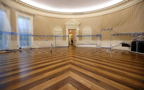 The Oval Office sits empty and the walls covered with plastic sheeting during renovation work at the White House August 11, 2017 in Washington, DC - Credit: Getty