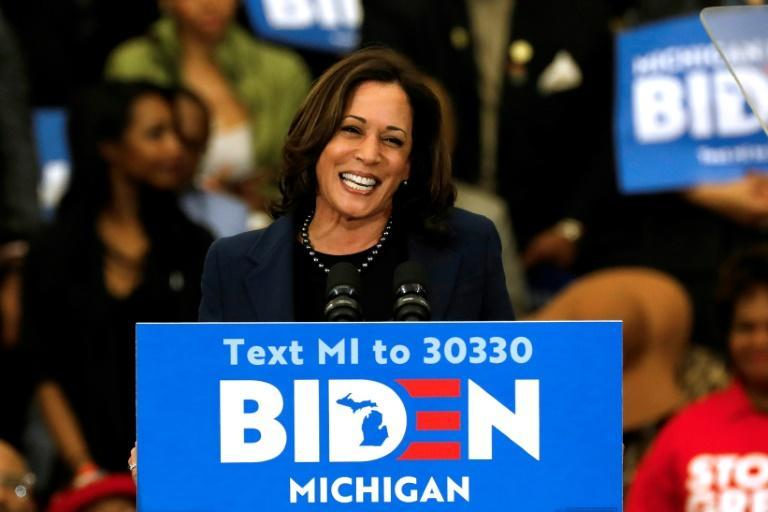 (FILES) In this file photo California Senator Kamala Harris endorses Democratic presidential candidate former Vice President Joe Biden as she speaks to supporters during a campaign rally at Renaissance High School in Detroit, Michigan on March 9, 2020.