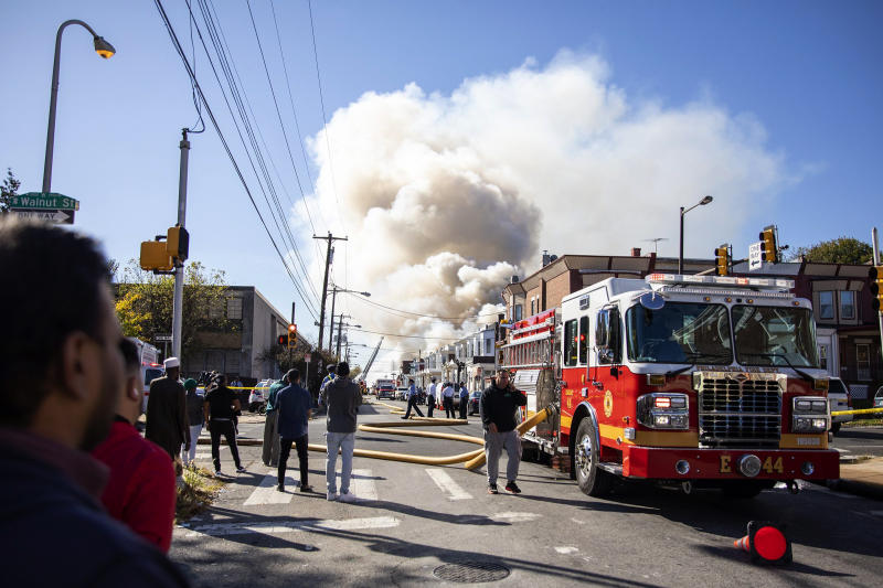 West Philadelphia Fire Department firefighters put out a fire that broke out Monday, Oct. 21, 2019, in Philadelphia. (Tyger Williams/The Philadelphia Inquirer via AP)