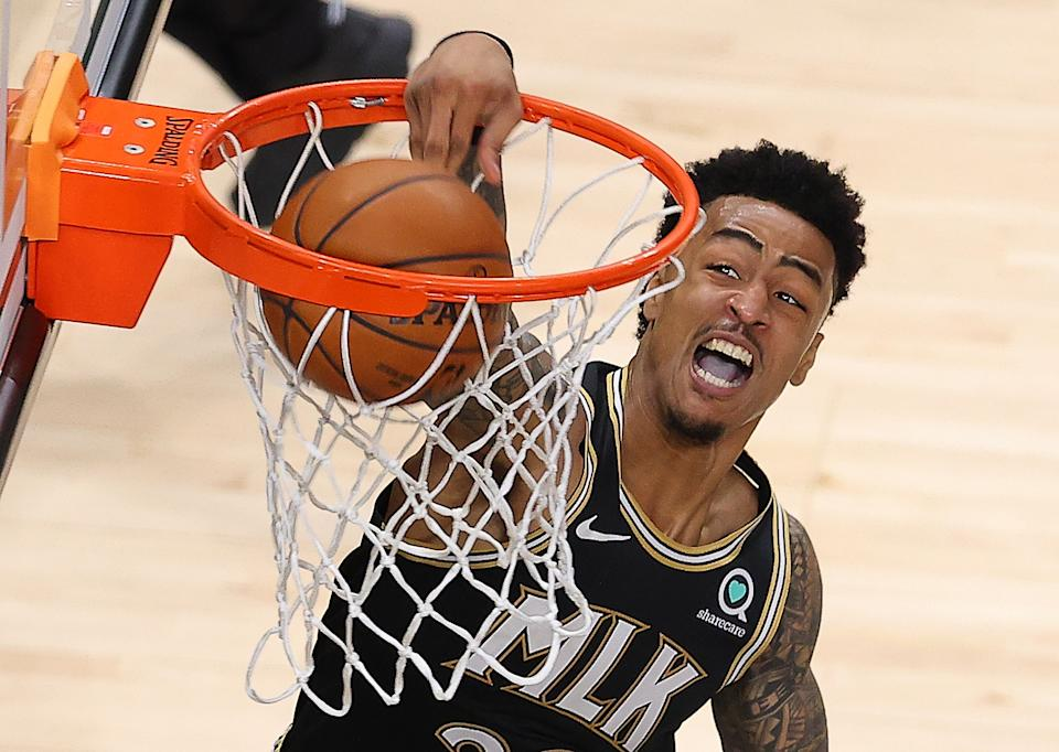ATLANTA, GEORGIA - MAY 30:  John Collins #20 of the Atlanta Hawks dunks against the New York Knicks in the first half during game four of the Eastern Conference Quarterfinals at State Farm Arena on May 30, 2021 in Atlanta, Georgia.  NOTE TO USER: User expressly acknowledges and agrees that, by downloading and or using this photograph, User is consenting to the terms and conditions of the Getty Images License Agreement.  (Photo by Kevin C. Cox/Getty Images)