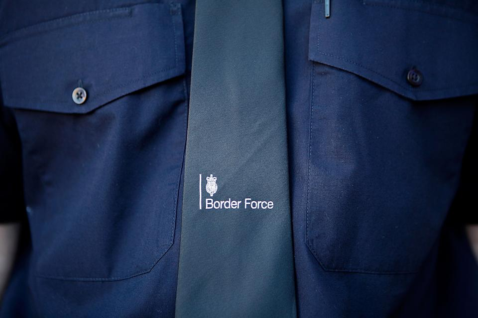LONDON, ENGLAND - MARCH 16:  A detail from the uniform of a Border Force officer on the new Border Force cutter HMC Protector, on March 16, 2014 in London, England. The cutter, officially launched by the Home Secretary Theresa May MP on 17th March 2014, is the fifth vessel to be added to the Border Force fleet protecting the United Kingdom's borders. Its crew of 12 officers are on board for 14 day stretches at a time, partolling the country's coastline. (Photo by Mary Turner/Getty Images)