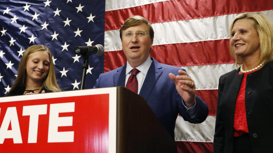 Lt. Gov. Tate Reeves, center, flanked by daughter Tyler Reeves, left, and wife, Elee Reeves, celebrates after being declared winner of the runoff for the Republican nomination for governor in Jackson, Miss., Tuesday evening, Aug. 27, 2019. Reeves beat former Mississippi Supreme Court Chief Justice Bill Waller Jr. in the runoff. (AP Photo/Rogelio V. Solis)
