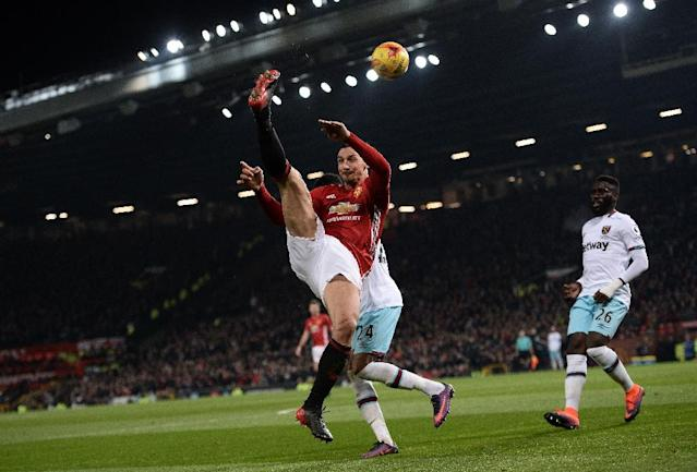 Manchester United's Zlatan Ibrahimovic makes an acrobatic cross during their League Cup quarter-final against West Ham (AFP Photo/Oli SCARFF )
