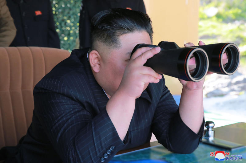 """This Thursday, May 9, 2019, photo provided Friday, May 10, 2019, by the North Korean government shows North Korean leader Kim Jong Un, observing a military test in North Korea. North Korea fired two suspected short-range missiles toward the sea on Thursday, South Korean officials said, its second weapons launch in five days and a possible warning that nuclear disarmament talks with Washington could be in danger. Independent journalists were not given access to cover the event depicted in this image distributed by the North Korean government. The content of this image is as provided and cannot be independently verified. Korean language watermark on image as provided by source reads: """"KCNA"""" which is the abbreviation for Korean Central News Agency. (Korean Central News Agency/Korea News Service via AP)"""