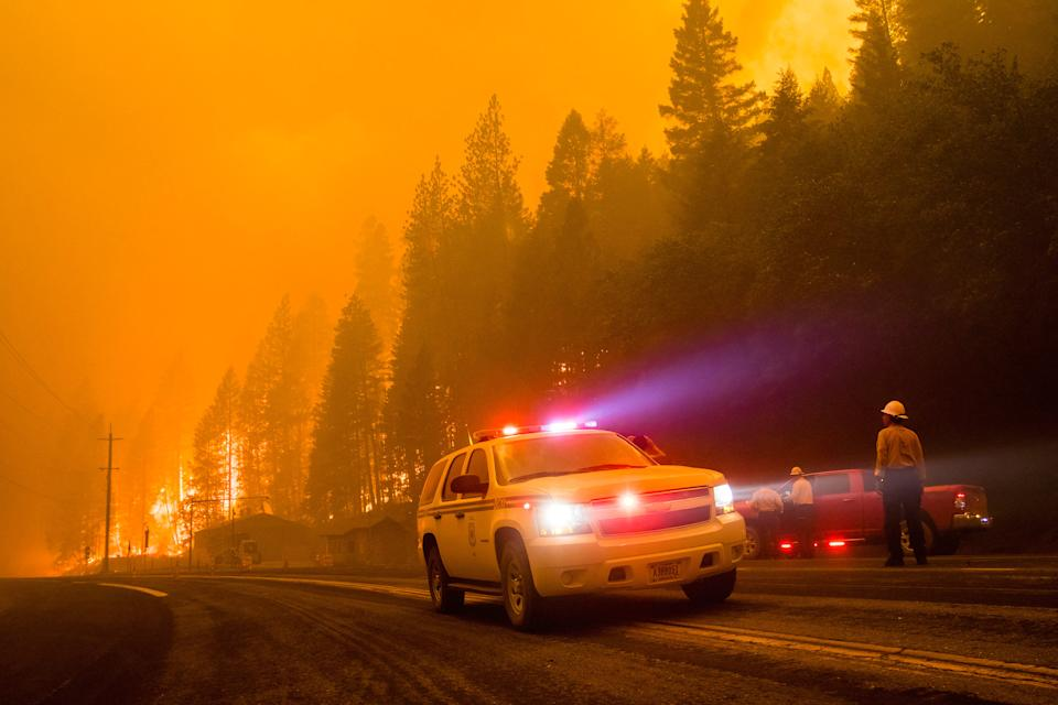 July 24, 2021, California, United States: Firefighter car turn around as active flames reach highway 70..The Dixie fire continues to burn in California burning over 180,000 acres with 20% containment. (Ty Oneil/SOPA Images via ZUMA Press Wire)