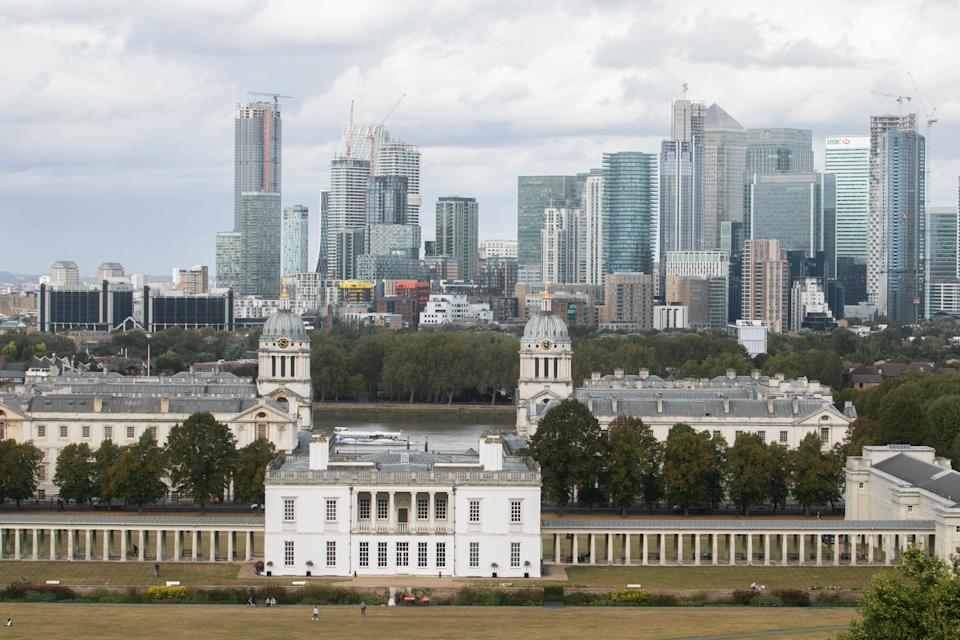 A view of the Greenwich old naval college at the foreground and Canary Wharf skyline and financial district in London. (Photo by Amer Ghazzal / SOPA Images/Sipa USA)