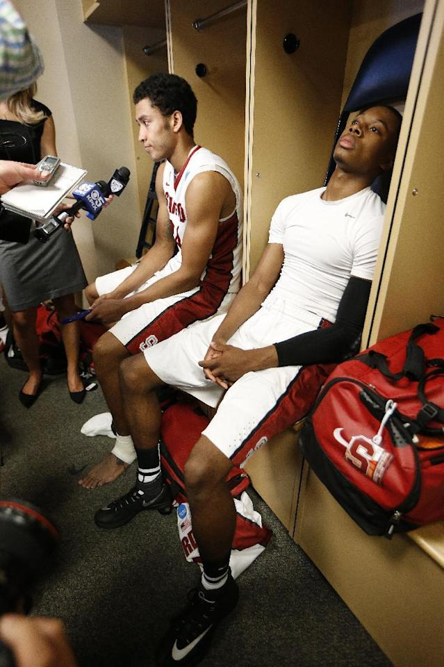 Stanford's Wade Morgan, right, and Josh Huestis sit in the locker room after a regional semifinal game at the NCAA college basketball tournament, Thursday, March 27, 2014, in Memphis, Tenn. Dayton won 82-72. (AP Photo/Mark Humphrey)