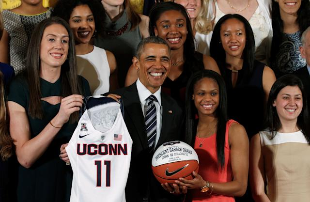 U.S. President Barack Obama poses for a photo during a ceremony honoring the University of Connecticut (UConn) Huskies women's basketball team for their 2016 NCAA Championship at the White House in Washington May 10, 2016. REUTERS/Kevin Lamarque