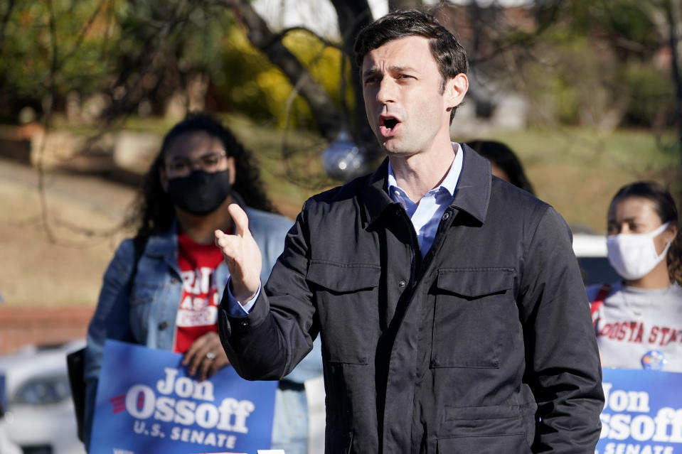 Democratic nominee for U.S. Senate from Georgia Jon Ossoff speaks after voting early in Atlanta on Tuesday, Dec. 22, 2020. For the second time in three years, Jon Ossoff is campaigning in overtime. The question is whether the 33-year-old Democrat can deliver a win in a crucial Jan. 5 runoff with Republican Sen. David Perdue. (AP Photo/John Bazemore)