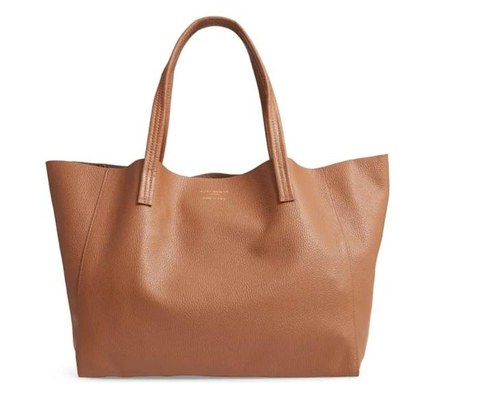 <p>This <span>Kurt Geiger London Violet Leather Tote</span> ($229) comes in several shades including a few metallic choices.</p>