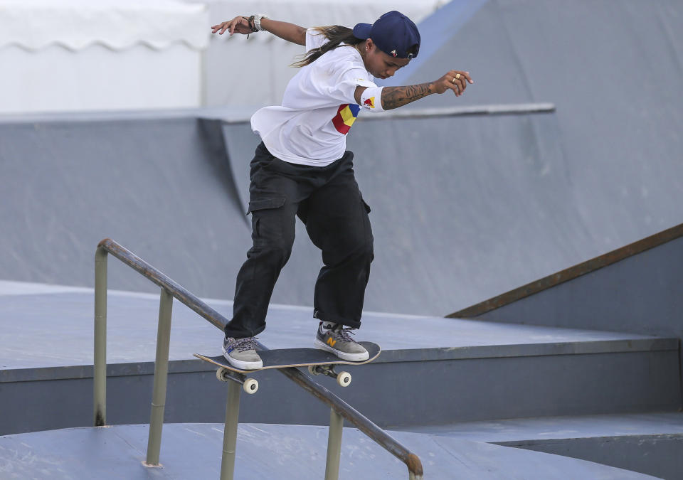 Philippines' Margielyn Didal navigates the rails during the street event finals of skateboarding at the 30th South East Asian Games in Tagaytay City, Cavite Province, Philippines, on Saturday, December 7, 2019. (AP Photo/Jijo de Guzman)
