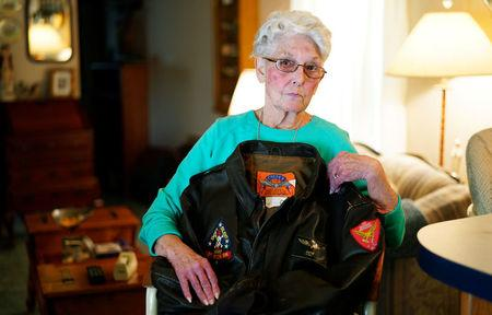 """FILE PHOTO: Shirley Hollenback, wife of Gerald """"'Cactus"""" Hollenback, whose husband's ashes were lost by Sunset Mesa Funeral Directors poses with his Marine Corps bomber jacket in her home in Montrose, Colorado, U.S., December 16, 2017.    REUTERS/Rick Wilking"""
