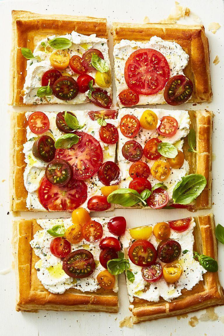 """<p>Stick to tradition while highlighting the season's best with this fresh take on a pizza pie. It's seriously easy to make: Spread a layer of ricotta on frozen puff pastry before topping it with an array of tomatoes, herbs and other spices. </p><p><a href=""""https://www.goodhousekeeping.com/food-recipes/healthy/a22750354/herbed-ricotta-and-fresh-tomato-tart-recipe/"""" rel=""""nofollow noopener"""" target=""""_blank"""" data-ylk=""""slk:Get the recipe for Herbed Ricotta and Fresh Tomato Tart »"""" class=""""link rapid-noclick-resp""""><em>Get the recipe for Herbed Ricotta and Fresh Tomato Tart »</em></a></p>"""