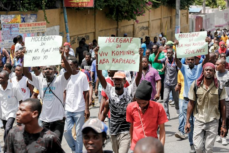 Protesters angry with the Haitian governmen and a budget viewed as unfavorable to the poor march in Port-au-Prince