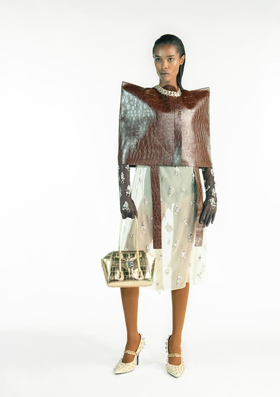 <h2>Big Shoulders<br></h2><br>Back in the '30s, designers like Elsa Schiaparelli began adding shoulder pads and bubble-like sleeves to dresses and outerwear as a way to make women feel confident and powerful — which, in today's political landscape, is just as important as it was then, post-Great Depression. With that, it makes total sense that Matthew Williams would showcase strong shoulders for his debut at Givenchy, and that Rick Owens would follow suit. Chanel, Louis Vuitton, Isabel Marant, and Balenciaga also presented big, slouchy shoulders in their spring collections. <br><br><em>Givenchy</em>