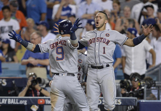 <p>Houston Astros left fielder Marwin Gonzalez (9) celebrates with shortstop Carlos Correa (1) after hitting a solo home run in the 9th inning against the Los Angeles Dodgers in game two of the 2017 World Series at Dodger Stadium. Mandatory Credit: Gary A. Vasquez-USA TODAY Sports </p>