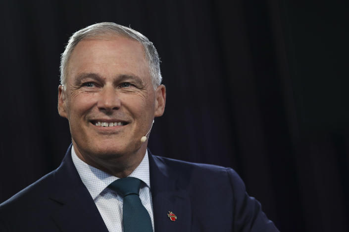 Democratic presidential candidate and Washington Gov. Jay Inslee does a television interview with MSNBC in the spin room ahead of the first Democratic presidential primary debate for the 2020 election at the Adrienne Arsht Center for the Performing Arts, June 26, 2019 in Miami, Florida.   Drew Angerer—Getty Images