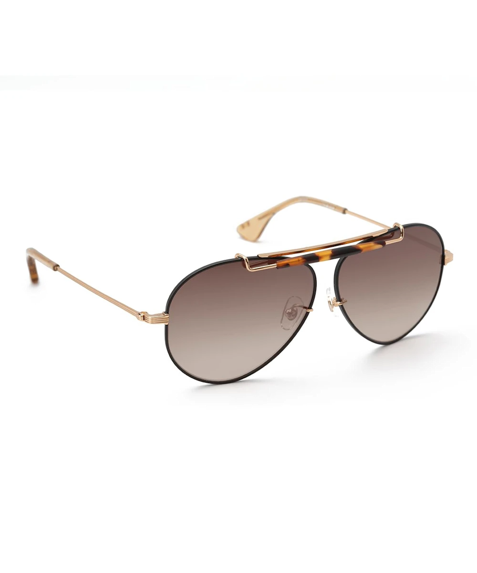 """<h3>Krewe Aviator Sunglasses</h3><br>For non-NOLA natives, Krewe's name may not carry much meaning. But for the New Orleans-based eyewear brand, it's a direct tie to its physical roots. Traditionally affiliated with Mardi Gras, a krewe describes a group that stages a parade for a carnival celebration. The word has since become synonymous with your local community or a tight-knit group of friends. The brand itself has a mighty large krewe having been spotted on the likes of Beyoncé, Kendall Jenner, Gigi Hadid, and many more. The glasses themselves are made from plant-based acetate, rilsan (a 50% bio-waste-based material), and premium metals.<br><br><strong>Krewe</strong> Carver, $, available at <a href=""""https://go.skimresources.com/?id=30283X879131&url=https%3A%2F%2Fwww.krewe.com%2Fcollections%2Fsun%2Fproducts%2Fcarver-24k-matte-black-havana-mirrored"""" rel=""""nofollow noopener"""" target=""""_blank"""" data-ylk=""""slk:Krewe"""" class=""""link rapid-noclick-resp"""">Krewe</a>"""