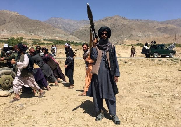 Taliban soldiers stand guard in Panjshir province northeastern of Afghanistan, Wednesday, Sept. 8, 2021. The Taliban government is reportedly ramping up pressure on neighbouring countries to return former Afghan air force personnel along with their equipment. (Mohammad Asif Khan/Associated Press - image credit)