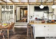 "<p>A dropped floor makes a <a href=""https://www.housebeautiful.com/design-inspiration/g15915375/rustic-kitchens/"" rel=""nofollow noopener"" target=""_blank"" data-ylk=""slk:rustic kitchen"" class=""link rapid-noclick-resp"">rustic kitchen</a> feel even larger and special. The exposed wood beams in the ceiling of this kitchen by Jane Hawkins Hoke give it that farmhouse vibe while the fresh coat of paint and pristine condition assure a contemporary, clean atmosphere. </p>"