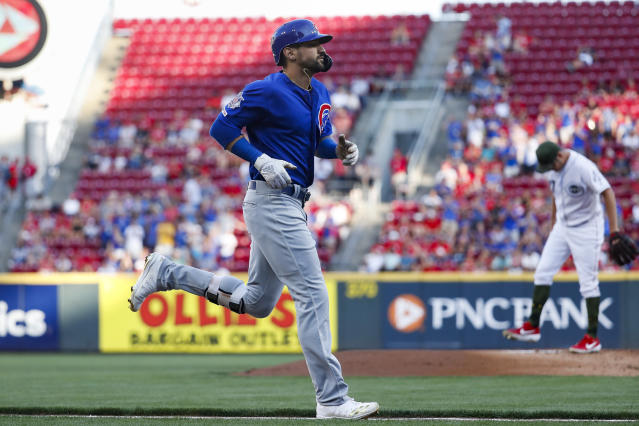 Chicago Cubs' Nicholas Castellanos runs the bases after hitting a solo home run off Cincinnati Reds starting pitcher Trevor Bauer, right, in the first inning of a baseball game, Friday, Aug. 9, 2019, in Cincinnati. (AP Photo/John Minchillo)