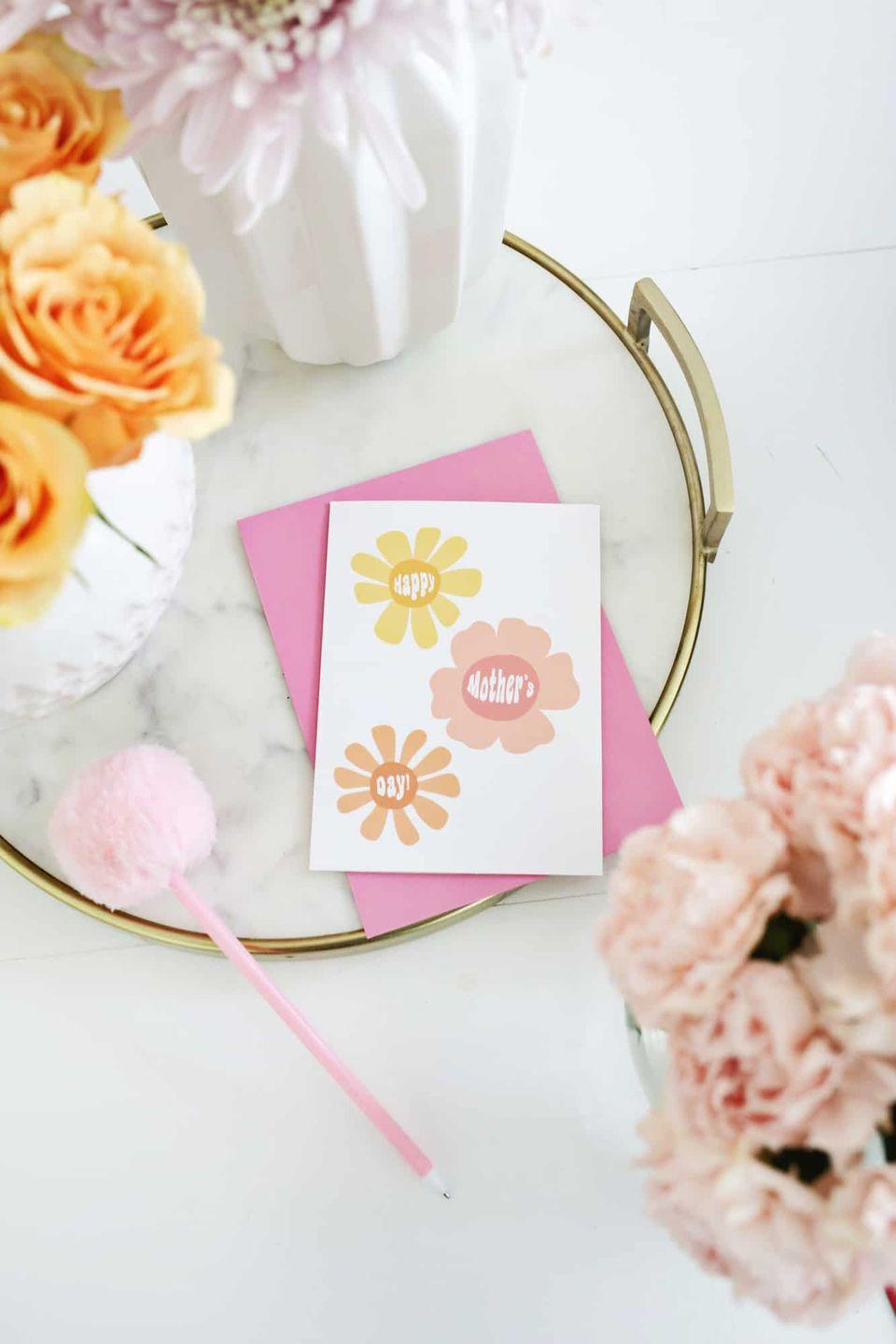 """<p>If your mom grew up in the '70s, this groovy flower power card will make her smile. It's about as minimal as DIY gets, so even if you have very little time to craft, you can still create something memorable. </p><p><strong>Get the printable at <a href=""""https://abeautifulmess.com/mothers-day-card-printables-theyre-free/"""" rel=""""nofollow noopener"""" target=""""_blank"""" data-ylk=""""slk:A Beautiful Mess"""" class=""""link rapid-noclick-resp"""">A Beautiful Mess</a>. </strong></p><p><a class=""""link rapid-noclick-resp"""" href=""""https://www.amazon.com/Sharpie-S-Gel-Medium-Point-0-7mm/dp/B082PN4X5J?tag=syn-yahoo-20&ascsubtag=%5Bartid%7C2164.g.35668391%5Bsrc%7Cyahoo-us"""" rel=""""nofollow noopener"""" target=""""_blank"""" data-ylk=""""slk:SHOP SHARPIE PENS"""">SHOP SHARPIE PENS</a></p>"""