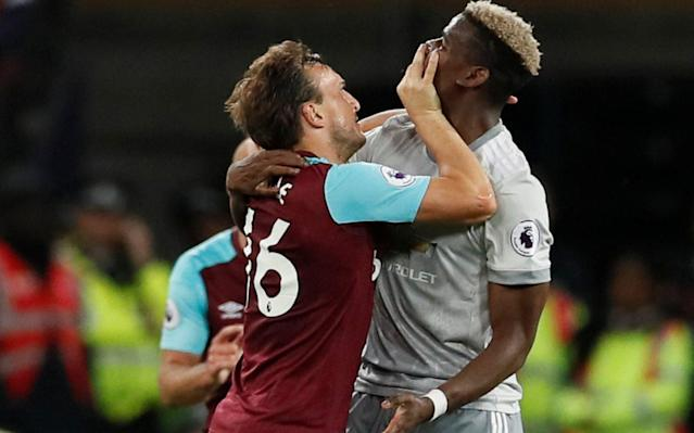 "Unable or unwilling to give one another a game, these two tired defensive teams did at least provide us all with a fight when Mark Noble briefly lost the plot and squared up to Paul Pogba, in a moment of aggravation as unexpected as a scrap in a quiet country pub. Before then, two five-man defences had faced off in a game of little ambition involving a Jose Mourinho masterplan which involved expending the minimum energy for the return of a single point. That was the minimum the Manchester United manager said that he had come for to ensure that the last game of the season at Old Trafford could run smoothly with second place already secured. It had been going to plan for Mourinho with precious little of note having happened when, with three minutes of the regulation 90 to go, Pogba fouled Cheikhou Kouyate, Noble fouled Pogba, Pogba reciprocated and within seconds it had escalated surprisingly. The West Ham captain was giving away around a foot in height when he went chest-to-chest with his opponent but it did not stop him grabbing the Frenchman's face, as if he was going to try to scale him rather than fight him. It should have been a red card for the West Ham captain, and Pogba, for all the sneakiness of the foul that had preceded it, did well to keep his cool, perhaps with the FA Cup final a week on Saturday in mind. The referee, Jonathan Moss, instead took the easy route out and booked both of them and, at the final whistle, Noble went over to make peace with an expression of mild embarrassment. There could yet be a Football Association charge for substitute Andy Carroll who came in the second wave and might even have thrown a punch at Luke Shaw, although he escaped any punishment on the night. Mark Noble grabs Paul Pogba by the neck Credit: REUTERS It had so nearly been one of those nights when nothing happens, and no-one seemed to care, when two teams were content to defend and the game ebbed away into moves that went nowhere. When it came to the fight Mourinho was indifferent, saying that from what he had seen of the replays, ""it looks like Paul and Noble are in love – hugs and kisses and changing shirts"". All he cared about was the point to ensure second place and the careful husbanding of resources ahead of the Cup final against Chelsea that will do much to define his season. It was for that reason he was making defensive substitutions in the last few minutes of a game, breaking up the rhythm of a match that barely had any rhythm in the first place. ""Any team that goes to this kind match where you need something to get some objective, you fight for that,"" Mourinho said. ""The best way to fight for the point was to try to win the match and be safe, which was what we tried. Luke Shaw returned to the Manchester United starting XI but with little impact Credit: Action Images ""But when the game goes to 70, 75 minutes, you don't win, you don't lose, you do the job. You get the point. You finish second and you can face the game on Sunday with a different perspective. We deserved a point, we deserved second position. When it is not possible to be champions, second position is the best available which was what we got."" He will play Sergio Romero in goal against Watford and Michael Carrick will captain the team in the last game of his playing career before he joins the coaching staff at Old Trafford. Then it will be about the long run-in to the FA Cup final a week on Saturday which, after a season when they have trailed far behind Manchester City, will sound a different note. It was not helped by the indifference with which the crowd regarded this final match of the season at the unloved stadium, where another mediocre Premier League campaign ends not so much with a whimper as a sigh. The away fans sang that it was the ""worst f------ ground we've ever seen"" and they got little dissent from the home fans, some of whom seemed even to be applauding them. The final week sweep-up of all those games that should have happened at other times is often a painful exercise in who-cares, but this one seemed particularly poignant falling on the second anniversary of the last game at Upton Park. It was the same two teams that contested that epic goodbye that started with Jesse Lingard Snapchatting the attack on the away team bus and ended with a rattling good comeback and a 3-2 West Ham win that no-one was expecting. David Moyes praised his players for their performances. ""If we couldn't get three points than we were going to make sure we got one,"" he said – it was that kind of night. Moyes said he thought little of the fight itself. ""It had never been that type of game,"" he said. ""It came out of nowhere."" Marko Arnautovic did his best and was better when Carroll joined him in attack in the second half. The goalkeeper Adrian denied Alexis Sanchez and Lingard twice, also pushing Shaw's drive onto the post. It was the fight that people will remember of this night, if they remember anything at all. 9:45PM What a difference five minutes make The two midfielders embrace more warmly at full-time Credit: AP Photo/Alastair Grant 9:39PM Well, this isn't very pleasant Noble shoves his hand into Pogba's face with force Credit: REUTERS/David Klein First Noble goes for the ear and then the mouth. What a curious assault Credit: REUTERS/David Klein 9:37PM Full time Manchester United earn the point they needed to secure second place after a cautious and at times tedious encounter. 9:36PM 90+4 min West Ham 0-0 Man Utd Man Utd make their last substitution: Bailly on for Valencia. 9:35PM 90+3 min West Ham 0-0 Man Utd Luke Shaw has turned his ankle. 9:35PM 90+2 min West Ham 0-0 Man Utd Rashford is caught offside. The replay of Noble's aggressive swipe to the face would argue that he deserved something more severe than a yellow. Lucky boy and because he was booked, it cannot be revisited. 9:33PM 90+1 min Ashley Young replaces Alexis Sanchez. 9:33PM 90 min West Ham 0-0 Man Utd Lindelof jumps into Carroll and concedes a free-kick, 22 yarsd out, left of centre. Lanzini takes and spoons it over the bar. Three minutes will be added on. 9:32PM 89 min West Ham 0-0 Man Utd Both are booked. Typical, the game sparks into life after 87 dull minutes and now there's no time left. 9:31PM 87 min West Ham 0-0 Man Utd At last, a ding-dong. Noble shoves Pogba after Pogba's trip on him. Noble had slid in to try to foul Pogba, missed so the France midfielder went for him. The two got in each other's faces and Noble put his hands in Pogba's face. Carroll flies into shove Pogba away and then out come the handbags. 9:27PM 85 min West Ham 0-0 Man Utd Mark Noble, with memories of Saturday's pearler fresh, whacks a 25-yarder over the bar, high, wide and hideous. 9:25PM 83 min West Ham 0-0 Man Utd Carroll lofts a sand-wedge pass with his left foot over the United midfield for Arnautovic to chase. He gets there before Lindelof, waits for Carroll's run into the box then pings a cross to the far post that Shaw, gallantly, wins with a backheader despite feeling the fire of Carroll's breath on his neck. 9:22PM 81 min West Ham 0-0 Man Utd Noble picks out Arnautovic's run with a sumptuous 35-yard arced pass. Arnautovic hits the dropping ball first time with a left-foot volley that trims the side netting. 9:20PM 79 min West Ham 0-0 Man Utd McTominay and Valencia combine on the right and the midfielder crosses deep where Rice wins the header. No poise. No precision. All muddle. 9:19PM 77 min West Ham 0-0 Man Utd Zabaleta hounds Shaw out of possession and Jones his to bail his team-mate out with a tackle. 9:17PM 75 min West Ham 0-0 Man Utd Kouyate jogs back on after treatment following a sack-of-spuds like fall during an aerial battle with Pogba. 9:16PM 74 min West Ham 0-0 Man Utd Manchester United substitution: Jesse Lingard off; Marcus Rashford on. 9:15PM 72 min West Ham 0-0 Man Utd Sanchez dribbles through the box, herded left by Ogbonna and Noble until he gets to the byline. Once there his quick feet turn Noble and he rolls a pass back to Pogba who tries a right-foot curler that starts on the right path but doesn't turn in enough to hit the target. Miss: West Ham 0 - 0 Man Utd (Paul Pogba, 71 min) 9:12PM 70 min West Ham 0-0 Man Utd Zabaleta and Kouyate team up to dispossess Lingard and storm forward but they run out of space and resort to a hit and hope cross into the box. Lindelof shields Arnautovic from the ball. 9:10PM 68 min West Ham 0-0 Man Utd Sanchez takes a corner after Shaw's cross is blocked. He stands it up for Smalling to head ... wide. 9:08PM 66 min West Ham 0-0 Man Utd West Ham substitution: Andy Carroll comes on for Masuaku. 9:06PM 64 min West Ham 0-0 Man Utd Good cross on the run from Valencia wide on the right towards the back post whither Pogba had made a clever run. Up he climbs to meet it but steers it wide. Miss: West Ham 0 - 0 Man Utd (Paul Pogba, 62 min) 9:04PM 62 min West Ham 0-0 Man Utd Arnautovic wakes the Irons fans from their slumber by tearing on a diagonal in-to-out run through the United box. Jones dives in but misses and Arnautovic bullocks round him. Jones, though, tenaciously gets up and blocks the intended cut-back for Lanzini and United regroup. 9:02PM 60 min West Ham 0-0 Man Utd Noble chips a 40-yard pass into the box for Arnautovic. Smalling comes over the top, holding on, to win the header. Arnautovic protests but the referee isn't having it. 9:00PM 57 min West Ham 0-0 Man Utd West Ham free-kick on the right, arced towards Kouyate at the back post. McTominay uses his strength and positioning to hold him off and shepherd the ball out for a throw. Join the club, Jose! Credit: DAVID KLEIN/REUTERS 8:58PM 55 min West Ham 0-0 Man Utd Lingard plays a one-two with Pogba. The West Ham defenders melt back towards goal, inviting him to shoot. He RSVPs in the affirmative and drills a shot that Adrian doesn't have to move to grasp as easy as pie. 8:55PM 53 min West Ham 0-0 Man Utd Do you remember Jorge Valdano, then of Real Madrid, calling Liverpool vs Chelsea in 2005 's--- on a stick' football? I'd like to hear what he thinks of this garbage. 8:54PM 51 min West Ham 0-0 Man Utd Pogba, 25 yards out, looks to lay it off to Shaw on the overlap, takes the opportunity to switch it on to his right then scuds a shot that is deflected and decelerated. 8:52PM 49 min West Ham 0-0 Man Utd Lingard with another of his abject corners that doesn't clear the West Ham near-post sentry. From the clearance Pogba works it out to Sanchez on the left of the box, parallel with the posts and draws Adrian out of goal. Sanchez switches it on to his right and tries to bend it in at the far post but there are too many West Ham defenders and they hustle it clear. 8:50PM 48 min West Ham 0-0 Man Utd Pogba cuts in from the left, slips a pass in to Lingard's feet and he dribbles towards goal on a diagonal path before skelping a right-foot shot that is deflected behind. 8:48PM 46 min West Ham 0-0 Man Utd 'Pogba plays like the team are 3-0 up,' says Gary Neville as we continue where we left off, ball pinging around a heavily congested middle third. 8:41PM Half time West Ham 0-0 Man Utd Here are the shot counts and paths ... West Ham vs Man Utd shots on goal ... the possession stats ... Possession: West Ham vs Man Utd ... and the weighted average touch positions which show Herrera as Man Utd's hub. Average touch positions (half time) 8:36PM Half time West Ham 0-0 Man Utd The half ends with Lingard's shot. United have had a few digs from distance and created their best chance for Shaw but their play lacks a cutting edge and a swagger. West Ham look dangerous on the break but once again it's one of those Premier League games that if you don't have your heart invested in either side you'd not give it your full attention. Too much insipid passing and mass defending. Pace and incisiveness would be a welcome addition in the second-half. 8:32PM 45 min West Ham 0-0 Man Utd Kouyate fouls Sanchez 40 yards out, to emphasise Gary Neville's point. They take it short and Lingard thrashes a shot with his laces from 25 yards, left of the D, that swerves and dips. Adrian, his feet in the wring starting position, adjusts smartly to push it wide. 8:30PM 43 min West Ham 0-0 Man Utd Sanchez picks up the ball on halfway and runs 15 yards until Joao Mario brings him down. Gary Neville points out that Sanchez is playing far to deep to be influential. He is constantly ball-hunting, as he did at Arsenal when possessed by Messiah complex, thinking only he could make the difference. 8:27PM 41 min West Ham 0-0 Man Utd Minutes of sterile possession from Manchester United who lack pace or playmaking guile. In the end Pogba loses patience and flays a shot wide. 8:25PM 39 min West Ham 0-0 Man Utd Pogba takes the ball forward towards halfway, overruns it and tries to win it back by lunging with his right foot and fells Kouyate with a kick on the shin. Awful ball control. 8:23PM 37 min West Ham 0-0 Man Utd Arnautovic again does Smalling, sprinting towards him, gulling him to commit and then beats him to the byline. He pulls back a cross to the near post for Joao Mario who cannot adjust his feet to flick the ball on target but stabs it behind. 8:21PM 36 min West Ham 0-0 Man Utd Lingard takes the corner from the right with his right foot, swinging it out to the edge of the box and West Ham easily clear and break. Their corners have been feeble so far. 8:20PM 34 min West Ham 0-0 Man Utd Cute diagonal from Rice up to Arnautovic who has two United defenders between him and De Gea and claims Lindelof fouls him to stop him. The referee doesn't agree and United hare up the right with Valencia who earns a corner. 8:18PM 33 min West Ham 0-0 Man Utd Lanzini tracks all the way back to the left-back position to try to tackle Valencia who fouls him. David Moyes and his ball-attracting cardigan Credit: Action Images via Reuters/John Sibley 8:16PM 30 min West Ham 0-0 Man Utd Cresswell who is still enterprising even though he is playing on the left side of a back three supports the attack down the right and when the ball arcs through the box he traps it and lines up a shot from 25 yards that he catches sweetly but sends it skimming wide of the right post. 8:14PM 28 min West Ham 0-0 Man Utd Arnautovic spurts down the right and burns off Smalling. His run narrows the angle for the shot so he tries to compromise with a cross that United scramble behind for a corner from which West Ham are penalised for being too handy in the box. 8:13PM 26 min West Ham 0-0 Man Utd Pogba's battle with Kouyate is turning nice and spicy. Zabaleta is all arms and legs when the ball from Valencia's cross leaps awkwardly and caught him on the left forearm. The ref waves play on and he scrambles the ball behind for a corner that United waste once more and West Ham break. 8:11PM 24 min West Ham 0-0 Man Utd Shaw hits the post after Manchester United turn up the intensity, Adrian gets a vital touch to stop the left-back scoring his maiden United goal. It was appropriate that Adrian saved West Ham because his weak save from Sanchez's straight shot set up the chance for Shaw. West Ham vs Man Utd 8:08PM 23 min West Ham 0-0 Man Utd From the goalkick, United win it back and Lingard has a dig from 25 yards that moves and dips but is too close to Adrian. 8:07PM 21 min West Ham 0-0 Man Utd Ogbonna blocks Shaw's low cross through the West Ham box. It's another low cross from Shaw which may be deliberate given the diddy nature of Sanchez and Lingard, though the former is a beast in the air. The ball ricochets to a spot about 25 yards out and McTominay is first to it an d fires a swerving shot wide. 8:05PM 19 min West Ham 0-0 Man Utd Free-kick, 40-yards out, too close to Adrian. United were dreadful at Brighton and are pretty terrible so far tonight. 8:03PM 16 min West Ham 0-0 Man Utd Sanchez and Pogba combine to go on a dribble apiece up the inside-right channel but lose the ball. Arnautovic gives them another opportunity with a foul. 8:02PM 13 min West Ham 0-0 Man Utd Manchester United doze when they take the corner and West Ham break sharply up the left. Lindelof comes out of the middle, Valencia hares back but Cresswell manages to get the cross in that bounces awkwardly through the box. Arnautovic arrives at the back post, too soon to meet the deflected flight of the ball perfectly and he has to crane his body backwards to improvise a finish that he can't get on target. 7:57PM 11 min West Ham 0-0 Man Utd Pogba gambols down the left, heads for the byline but Zabaleta slides in, misses with his leading foot then improvises to hook it behind with his left. United have a corner, which they waste with a shoddy delivery. 7:56PM 9 min West Ham 0-0 Man Utd It might be the positioning of the microphones, or the fact United's away fans habitually make more noise than their home ones, but it's only them you can hear. Lingard is dragged back by Joao Mario, who put an arm on his biceps as he writhed past. Lingard went down as if he'd had his legs whacked behind the knees with a thick walking cane. 7:53PM 7 min West Ham 0-0 Man Utd David Moyes is wearing a claret cardigan, the ind a Smiths' fan would have worn to Fresher's Week in 1986. Is he trying to do for the cardi what Rafa Benitez has done for the waistcoat. Arnautovic wriggles free of Herrera and strides towards the box. He tries to surprise De Gea with an early shot but toe-pokes it straight down the keeper's throat. 7:51PM 5 min West Ham 0-0 Man Utd Pogba sprays a pass out to Shaw on the overlap and he crosses low first-time on the run but its trajectory bends it away from Sanchez's run and Masuaku intercepts. 7:50PM 4 min West Ham 0-0 Man Utd Not a great deal of urgency so far or precision in the passing. Both sides making the kind of milky starts that have bedevilled their seasons. 7:48PM 2 min West Ham 0-0 Man Utd Kouyate snaps into a tackle and wins the ball off Pogba but Manchester United press hard to force their opponents backwards to pass it around in their half until they lose possession when they cross halfway. Joao Mario loses the 40-60 pass. 7:47PM 1 min West Ham 0-0 Man Utd Manchester United in their tin foil kit kick off as the bubbles swirl around the Olympic Stadium. Lingard chases a ball up the right from Valencia but Adrian gets to it first. When Manchester United try the same again Ogbonna heads it clear. 7:43PM Out come the teams Patrice Evra renews auld acquaintance with some of those vertical arm-wrestle position-style slappy handshakes. 7:40PM David Moyes speaks, too We pick up where we left off against Leicester. At home we've always got a chance, and hopefully this evening we can show that. We passed the ball well on Saturday, made quite a few openings. We didn't make the most of all of them. Let's hope we can take them tonight. 7:39PM Jose Mourinho speaks We need a point. We have two matches, but hopefully we can do it today. Are we going to play for the point? No. We're going to try to win. But we have a clear objective, which is to finish second. And to finish second, we need a point. 7:33PM Enormous excitement From Sky, who are treating it like a Championship match. Fifteen minutes build-up and straight into it. Let's hope it catches on. 7:02PM Those teams in black and white West Ham Adrian; Rice, Ogbonna, Cresswell; Zabaleta, Kouyate, Noble, Masuaku; Joao Mario, Lanzini; Arnautovic. Substitutes Hart, Evra, Obiang, Fernandes, Cullen, Carroll, Hugill. Jose Mourinho makes eight changes to Manchester United's starting XI after last Friday's defeat by Brighton Credit: Steve Bardens/Getty Images Man Utd: De Gea; Lindelof, Smalling, Jones; Valencia, Herrera, McTominay, Shaw; Lingard, Pogba; Sanchez. Substitutes Romero, Bailly, Blind, Young, Mata, Martial, Rashford. Referee Jonathan Moss (Horsforth) 6:54PM Man Utd switch formations And make eight changes. 8⃣ changes to tonight's #MUFC starting XI... #WHUMUNpic.twitter.com/ztLylXt6At— Manchester United (@ManUtd) May 10, 2018 6:53PM West Ham are unchanged We're unchanged, with Hart back in the squad after recovering from illness. pic.twitter.com/Bz6khYpD9X— West Ham United (@WestHamUtd) May 10, 2018 6:52PM Good evening A point tonight for Manchester United at West Ham United would guarantee a second place finish for them in the Premier League for the first time since 2012 and hence, their highest position since the retirement of Sir Alex Ferguson after winning their 20th title in 2013. It has, at least in the Premier League era, proved a fine staging post for top spot the following season - in fact the equivalent of Everest's camp four rather than base camp - as they went on to win the title the season after they were runners-up on each of the last six occasions (1992, 1995, 1998, 2006, 2010 and 2012) but didn't manage it the last three times they were second in the old League Division One (1968, 1980 and 1988). Omen or coincidence? Let's not have a heated debate. West Ham have enjoyed wazzing on United's chips in the past - most notably the 'obscene' victory in 1992 and Ludek Miklosko defying Andy Cole to earn a point that helped Blackburn to the title in 1995 - but their recent record at home, the raucous triumph in their final game at Upton Park two years ago when Michail Antonio and Winston Reid turned it round with a few minutes to go, has been painful. Brian McClair on Sir Alex Ferguson What can we expect tonight? While there's relief that they are now safe from the threat of relegation it is no panacea for solving West Ham's problems, the disconnect between those who love the club and those who own it, the loss of identity, terroir and a clear, coherent vision of what the club means, what it's for, that had sustained it since 1895. It's not presumptuous or hubristic for fans not to want Sam Allardyce or David Moyes. Pragmatism appeals to owners but fans see it for what it is: self-limiting. They want commitment, passion, style, not conservative football that's anathema to their ideal of what the club is and the values for which it has always stood. And that is precisely Manchester United's fans' predicament too, albeit at a more rarefied level. Who knows if there will be any signs of a brighter, more appropriate future for both sides tonight."
